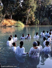 A baptism in the Jordan River - photo from FreeStockPhotos.com